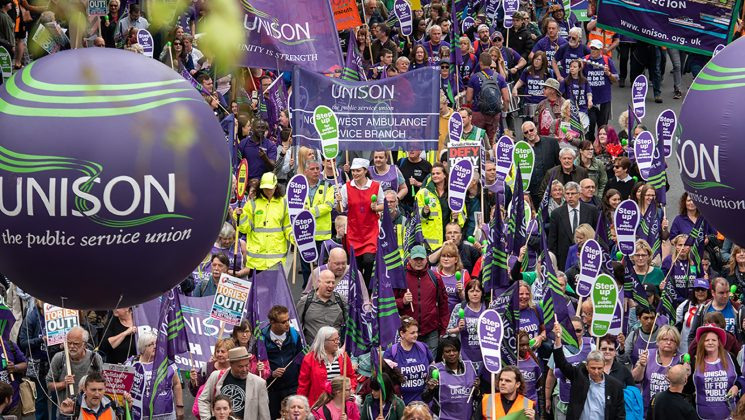 A large rally with UNISON flags and balloons